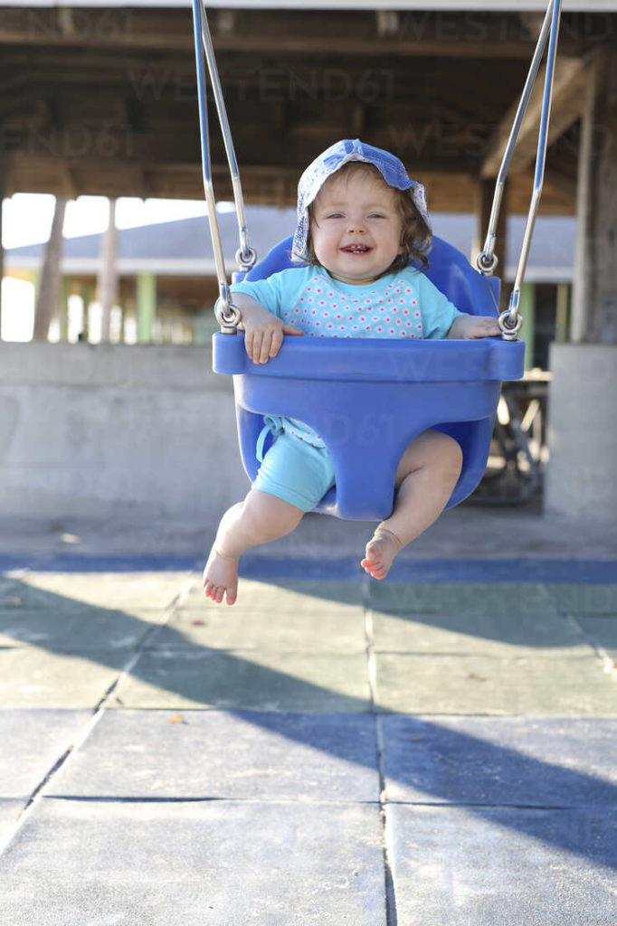 Baby to An Outdoor Baby Swing